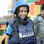Omayr dressing up as a journalist